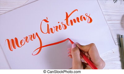 Merry Christmas congratulations. Calligrapher writes with...
