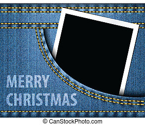 Merry Christmas greeting and blank photo frame in blue jeans pocket