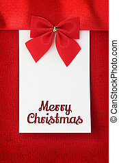Merry Christmas greeting card on red wool background