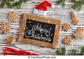 Merry Christmas greetings postcard with gingerbread cookie.