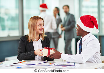 Merry Christmas - Portrait of African businessman giving...