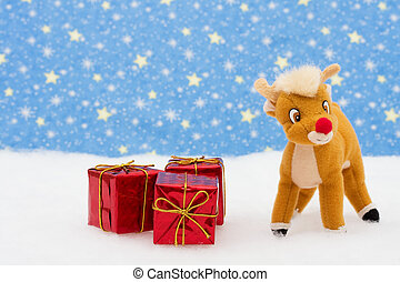 Reindeer in snow with presents on star background, merry Christmas