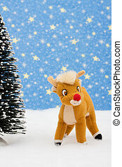 Reindeer in snow with tree on star background, merry Christmas