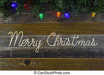 Merry Christmas rope on rustic wood