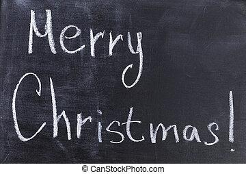 Merry Christmas text on chalkboard
