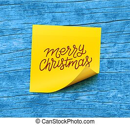 Merry Christmas text on yellow sticky note paper