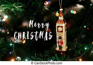 merry christmas text sign on  Queen's guard near big ben christmas ornament, cute toy soldier near golden watch clock english decoration close-up, surrounded by colorful lights