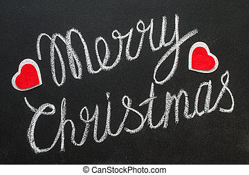 Merry Christmas text written on chalkboard