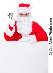 Merry Christmas! Traditional Santa Claus ringing a bell while leaning at the copy space and being isolated on white