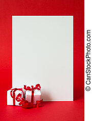 Two wrapped gifts represent christmas theme, with a blank white card for text