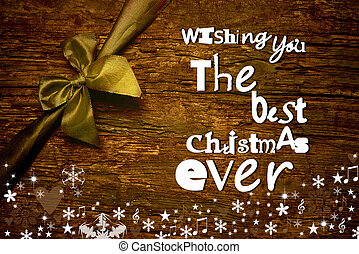Christmas greeting postcard, Merry Christmas wish message written on wooden background