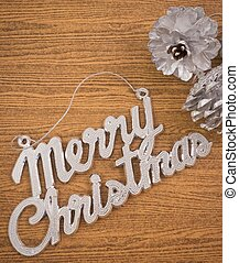 Merry Christmas Word with Two Silver Pinecones