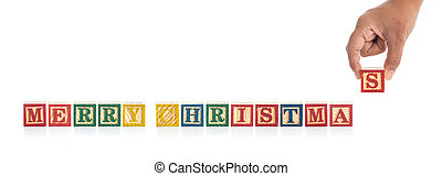 """MERRY CHRISTMAS"" write in colorful wood alphabet blocks and hand holding ""S"" isolated on white"
