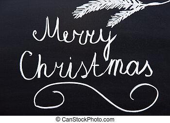 Merry Christmas written on a blackboard