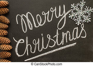 Merry Christmas written on a chalkboard concept happy new year.