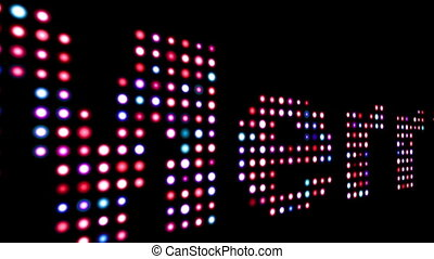 Merry colorful led text over black