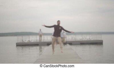 Merry company people rejoice pier - Men girls rejoice pier...
