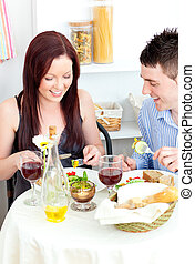 merry couple dining in the kitchen
