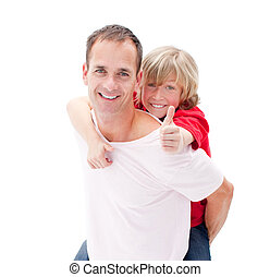 Merry father giving his son piggyback ride against a white background
