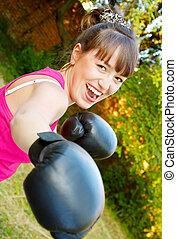 Merry girl in boxing-gloves