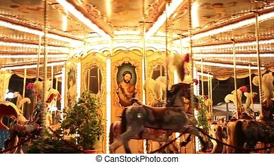 Merry-go-round close up - Merry-go-round in an amusement...