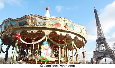 merry-go-round in paris, eiffel tower in background, in...