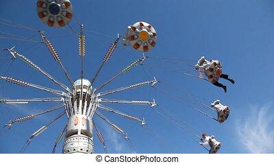 Merry-go-round on blue sky.