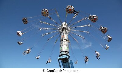 Merry-go-round on blue sky.