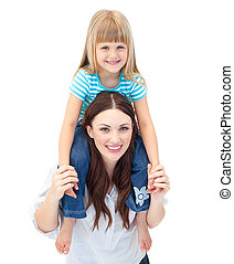 Merry mother giving her daughter piggyback ride