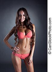 Merry suntanned girl advertises pink lingerie - Image of...