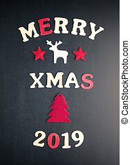 Merry xmas 2019 on a chalkboard