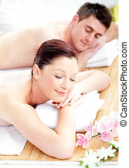 Merry young couple receiving a back massage