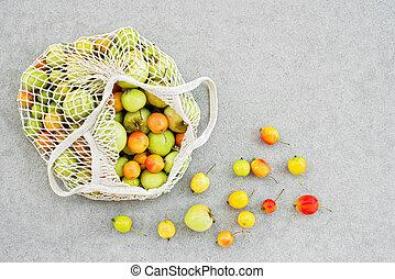 Mesh bag full of apples from the garden