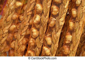 smoked garlic - Mesh bags with braid of smoked garlic at a ...