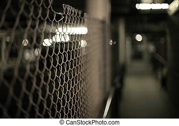 Mesh fence in an underground garage structure. Shallow DOF.