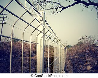 Mesh fence and sky - vintage style