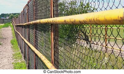 Mesh fencing. Iron fence on a horse farm. The grid of the corral