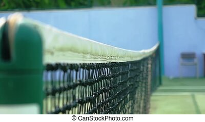 Mesh on the tennis court in sunny day. Close-up. slow...