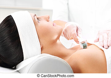 Mesotherapy microneedle - Beautician performs a needle...