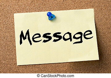 Message - adhesive label pinned on bulletin board