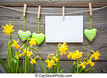 Message and hearts on the clothesline against wooden...