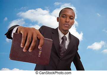 Message From Above - This is an image of man holding a...
