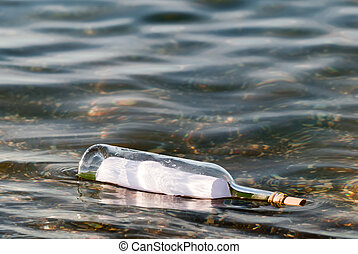 message in a bottle in the water