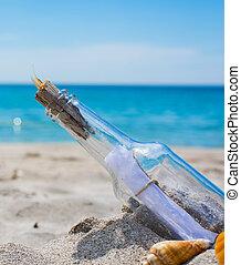 bottle on an empty beach
