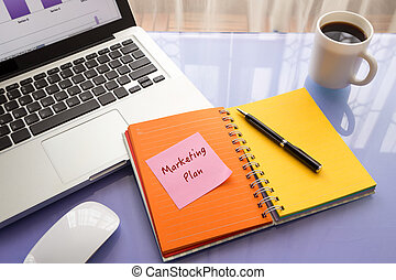 Message note on paper with Marketing Plan word