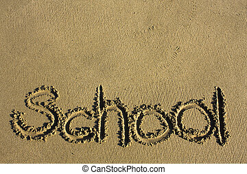 """Message says """"school"""" in the Sand on a Beach"""