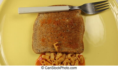 messege written on toast with spahgetti pasta letters