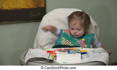 Messy baby finger painting closeup - A 4k video made with a...