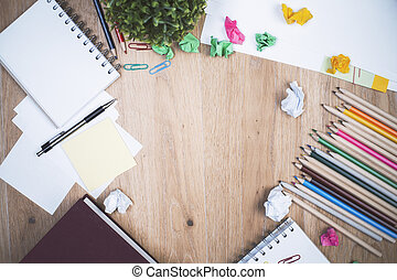 Messy desktop - Top view of messy wooden desktop with...