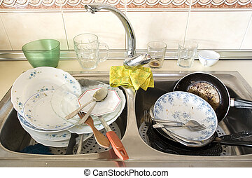 Messy kitchen - Dirty dishes in the sink after lunch